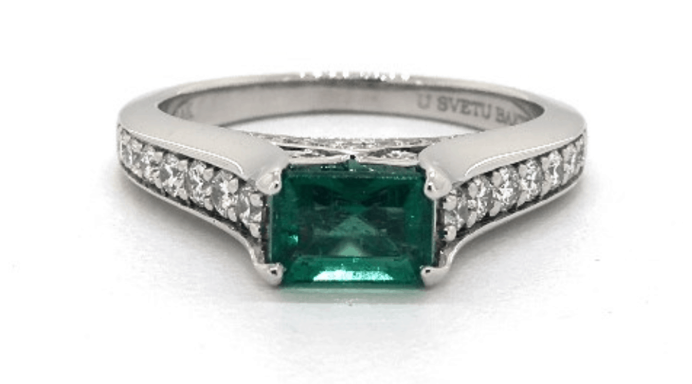 Emerald in Protective Tension Setting